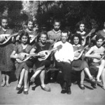 1934 - The mandolin orchestra. In the center seats Fabian the instructor who was also the music teacher of the home.