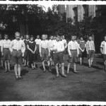 1931 - This picture was taken by Felek Grzyb A typical morning in the Home: after drinking the fish oil all children would place in rows' wearing the school uniform, in the back yard for morning exercise.